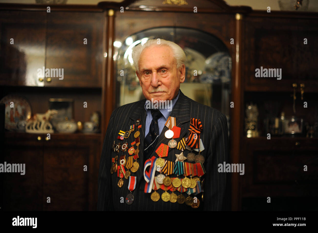 David Dushmann, a 91-year-old Russian Jew living in Munich, who in 1945 liberated the Auschwitz concentration camp with a tank of the Red Army. Later, he successfully worked as a fencer and over 30 years as a fencing nationalist of the Soviet Union. The picture shows him with his military and sports medals. Stock Photo