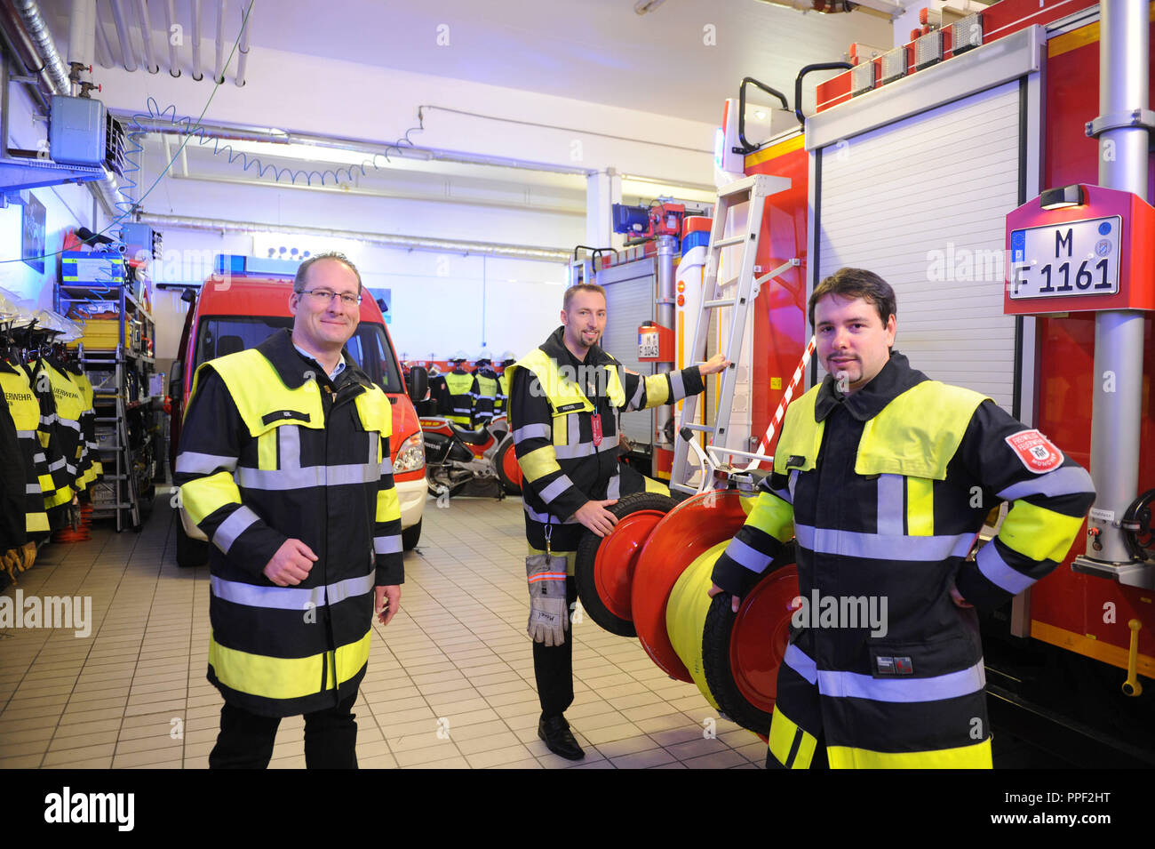 From left to right: Managing Director of volunteer firefighters Munich, Andreas Igl together with the Department Leaders of the Volunteer Fire Department Sebastian Meusel and Matthias Wolf in Sendling, Munich, Germany - Stock Image