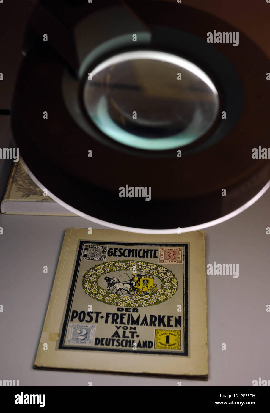 The book 'Geschichte der Post-Freimarken von Alt-Deutschland' (History of the Postage Stamps of Old Germany) in the Library of Philately and Postal History on the 3rd floor of the Munich City Library in Gasteig. - Stock Image