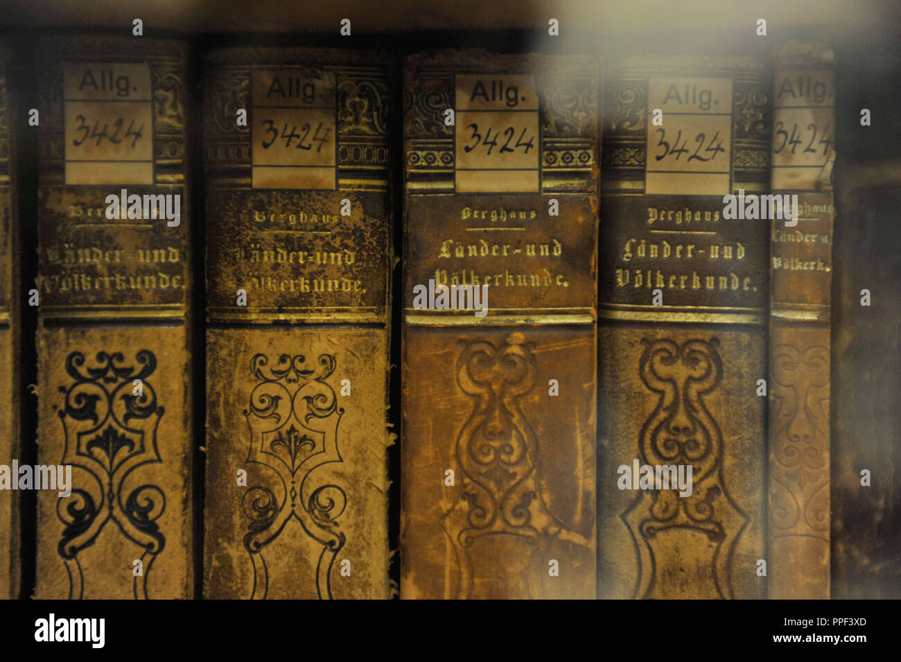 Old books in the library of the State Museum of Ethnology in the Maximilianstrasse 42 in Munich. - Stock Image