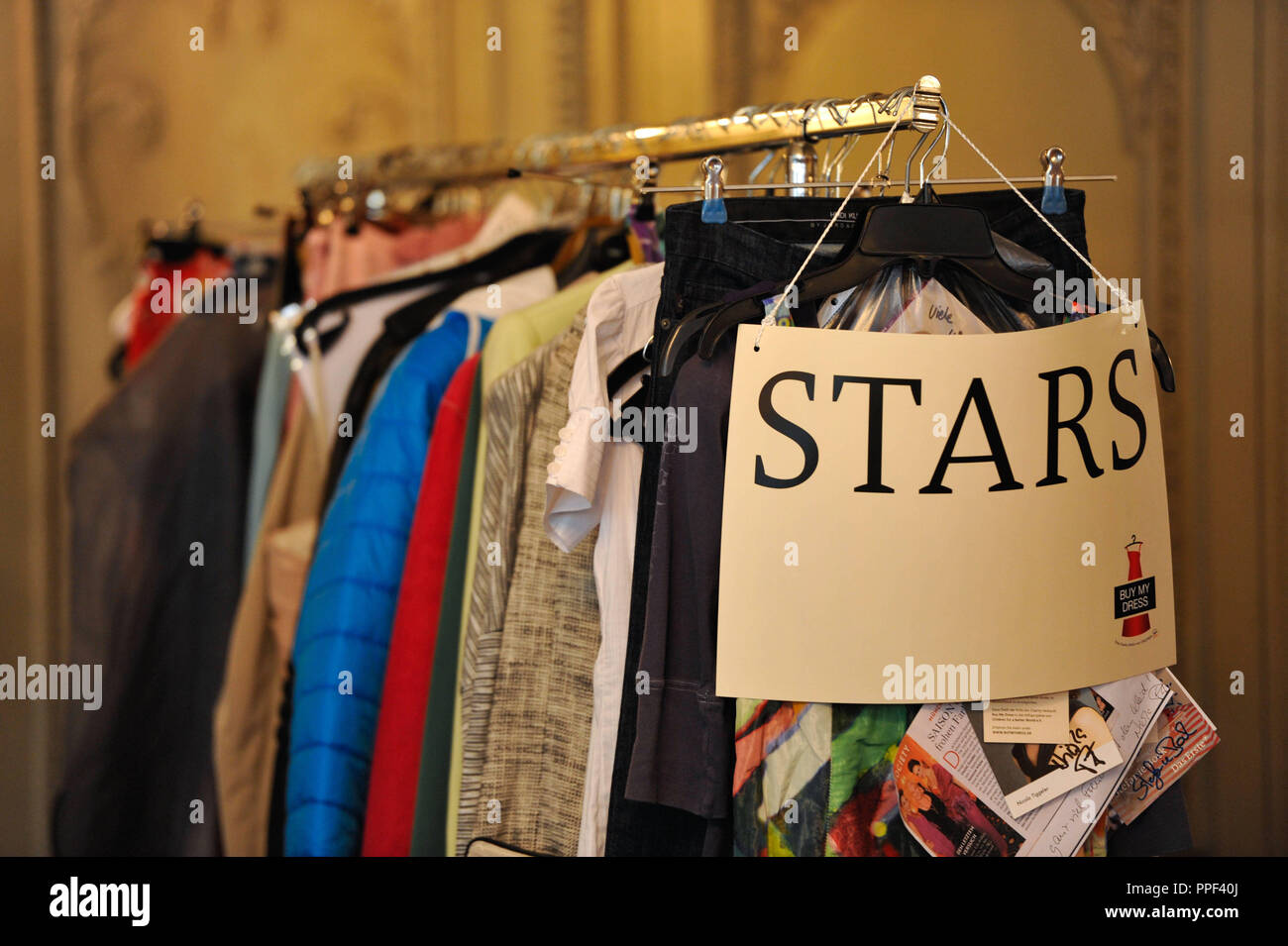 """The """"Buy My Dress"""" charity sale of dresses and accessories of celebrities at Hotel Bayerischer Hof in Munich in favor of the children's aid organization """"Children for a better World e.V."""". The picture shows a coat rack with the inscription """"Stars"""". Stock Photo"""