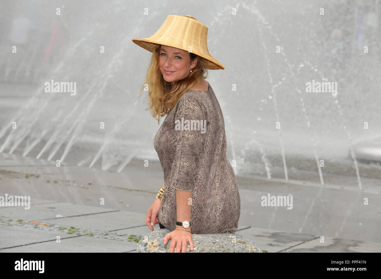 Diana Iljine, managing director of Muenchner Filmwochen and director of Filmfest Muenchen, pictured at the Stachus Fountain with her favorite piece for the summer. - Stock Image