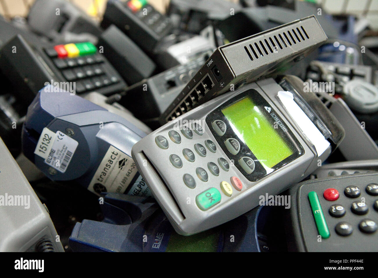 EC card readers in the recycling business of 'Weisser Raben' in Dornach, where are employed severely disabled and long-term jobless people. - Stock Image