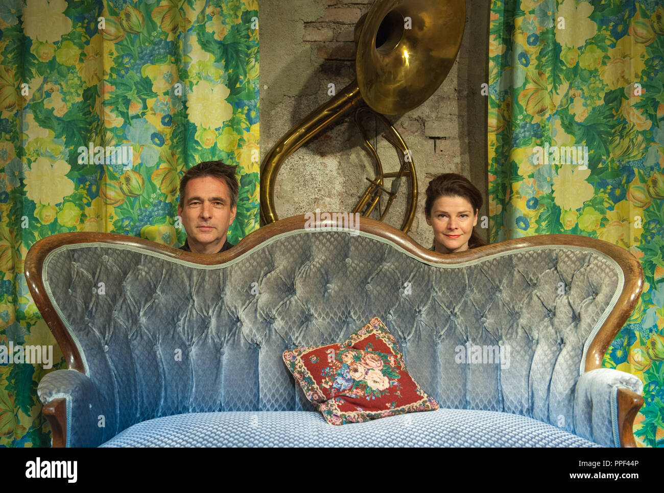 Tinka Kleffner and Roland Fritsch, organizers of the literature series 'Fabelhafte Couchpoeten' (Fabulous couch poets) at Ars Musica in Stemmerhof in the Plinganserstrasse. The picture shows them with their Viennese Baroque sofa on the stage. - Stock Image