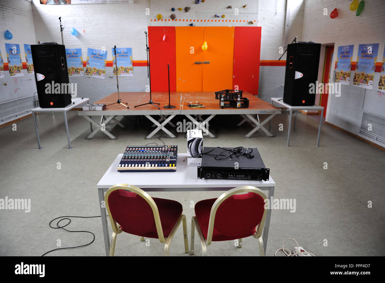 In the Multicultural Youth Centre in Westend various programs were planned as part of the World Neighbours' Day but unfortunately the weather did not cooperate. Therefore the stage was laid indoors spontaneously. Stock Photo