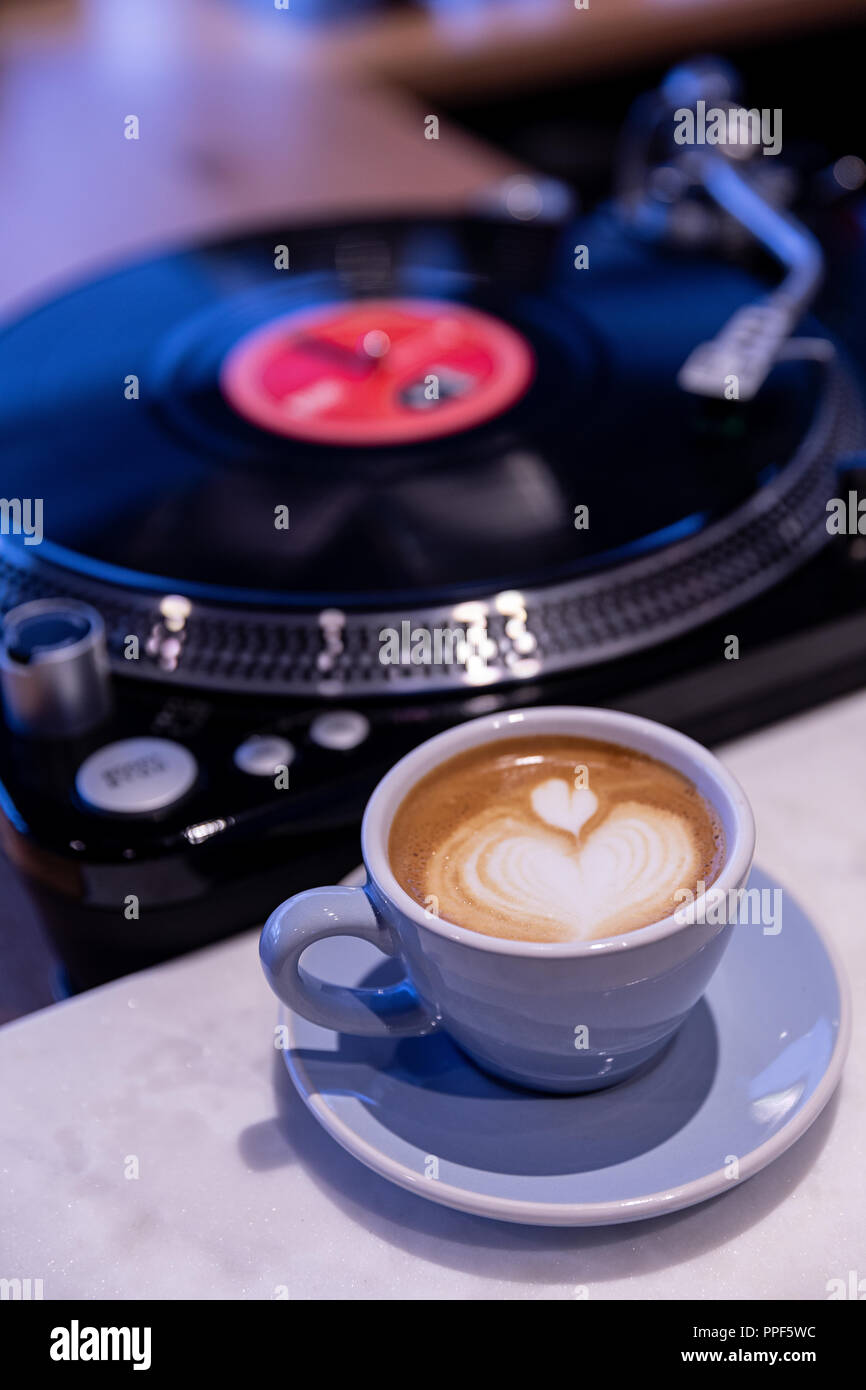Coffee Cup On White Table With Record Turntable Stock Photo Alamy