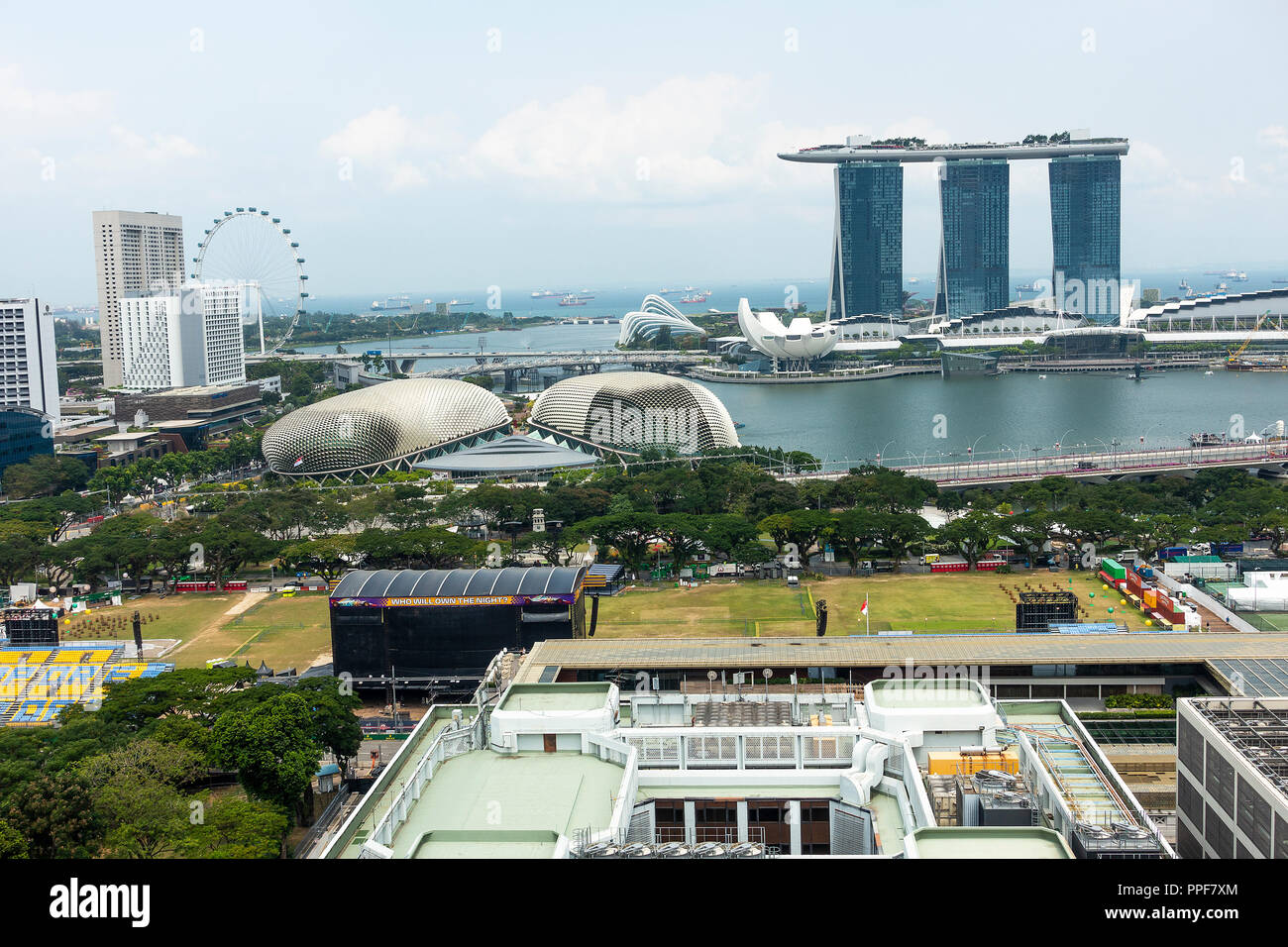 An Aerial View of The Padang with The Singapore Flyer, Marina Bay Sands Hotel, and The Esplanade Theatres in Republic of Singapore Asia Stock Photo