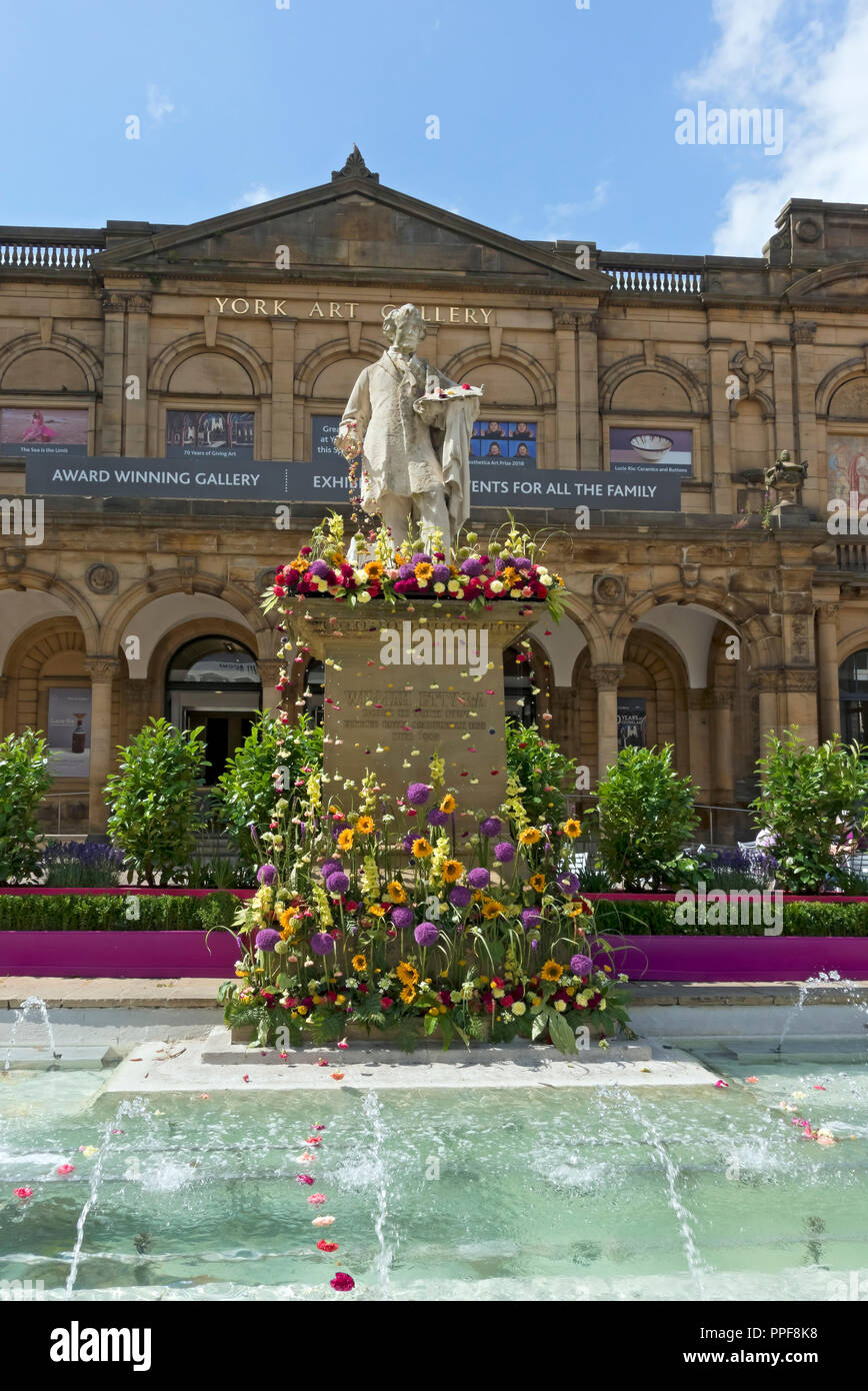William Etty statue decorated with flowers for the Bloom Festival Exhibition Square York North Yorkshire England UK United Kingdom GB Great Britain Stock Photo