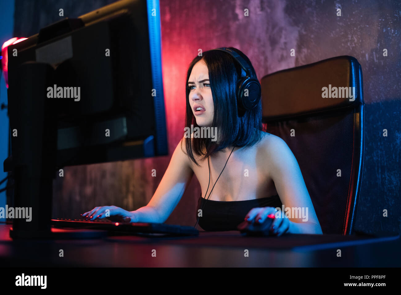 Portrait of a worried woman using a PC in the night at home. Stock Photo