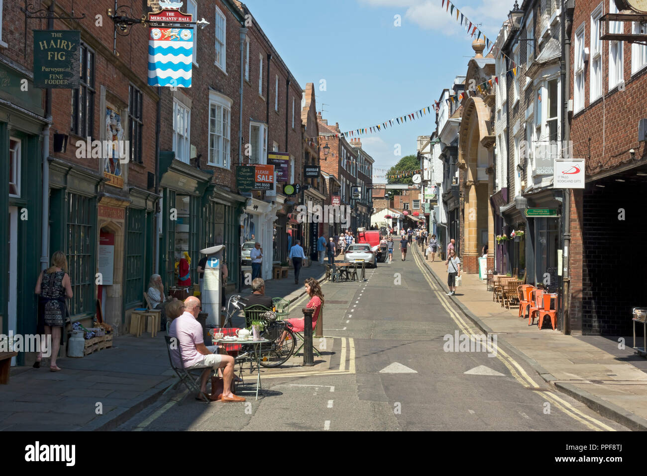 Cafes and shops in summer Fossgate York North Yorkshire England UK United Kingdom GB Great Britain - Stock Image