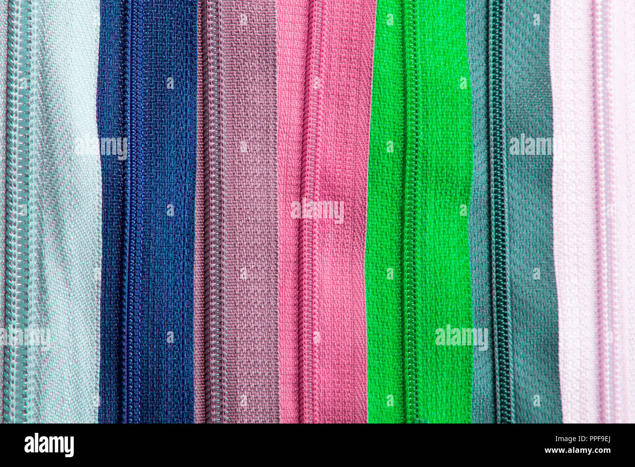 Colorful zippers texture for background - Stock Image