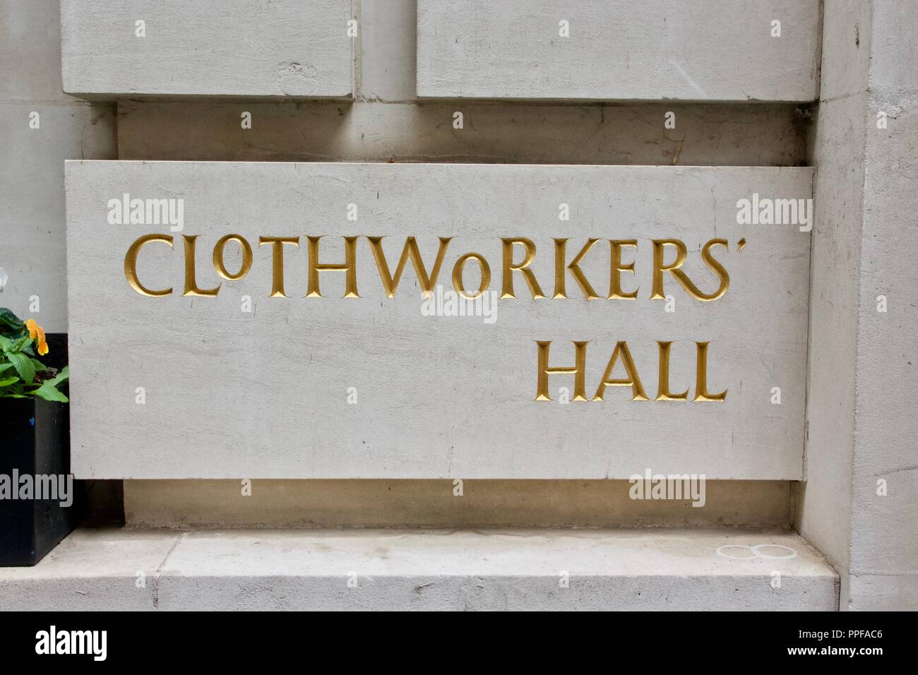 A gold sign outside the Clothworkers' Hall, part of the Clothworkers Company at Dunster Court, City of London - Stock Image