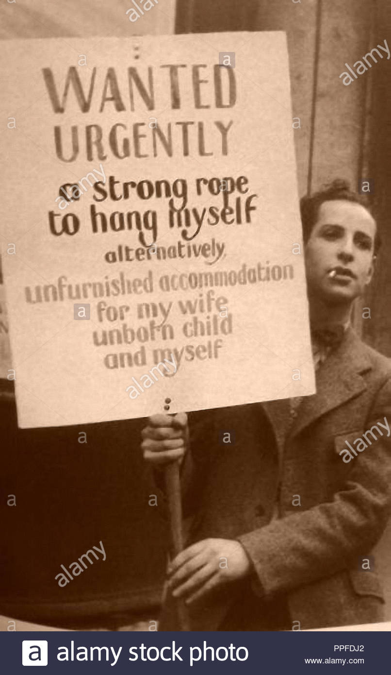 young unemployed man standing in the street during the great  depression in the 30s in USA - Stock Image