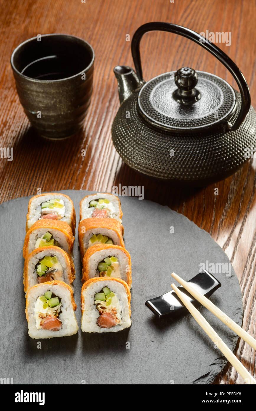 Salmon and Unagi sauce rolls - Stock Image