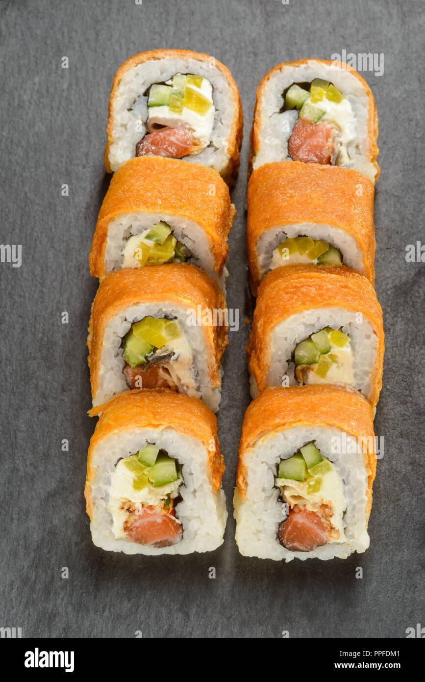 Eel and pickled radish rolls - Stock Image