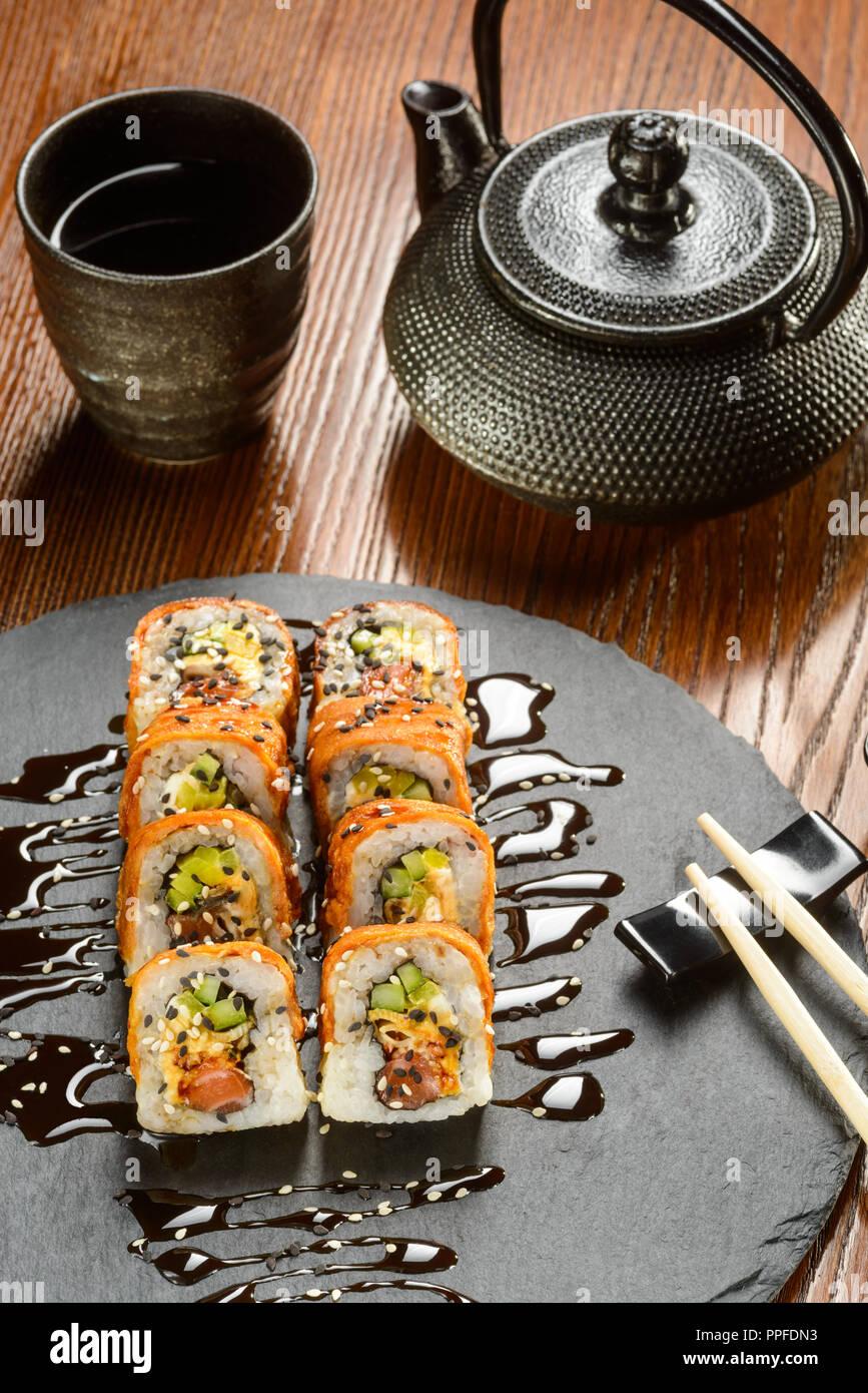 Smoked salmon rolls and tea - Stock Image