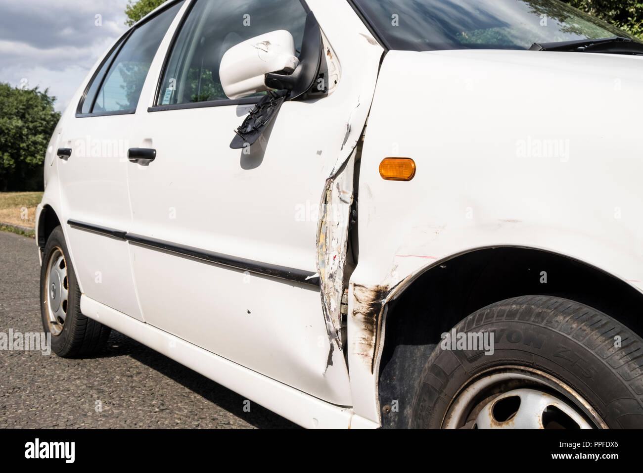 Car accident. Damaged car door, wing and broken wing mirror following a collision, Nottinghamshire, England, UK - Stock Image