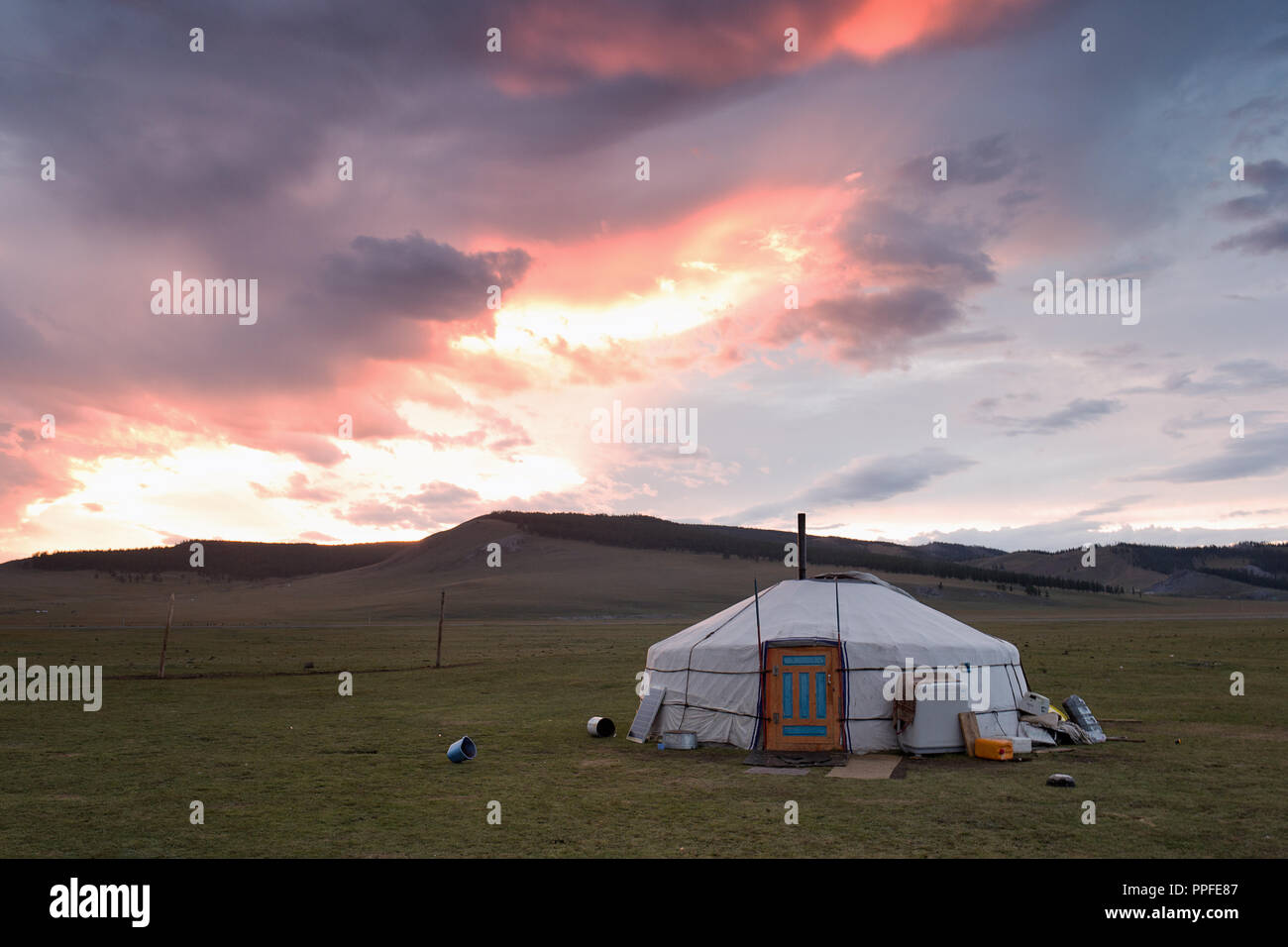 Dramatic sunset over a mongolian yurt, Khatgal, Mongolia - Stock Image