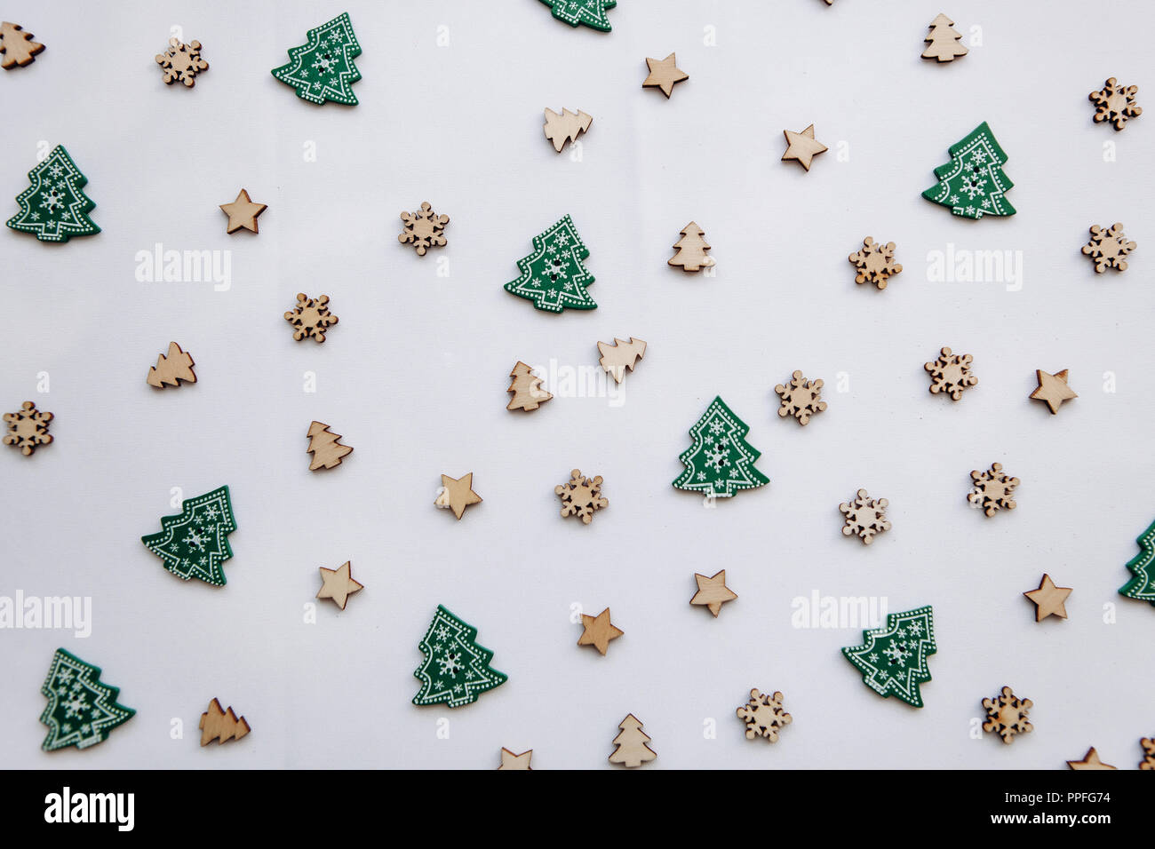 Small Wooden Christmas Trees And Snowflakes Festive Decorated Background Christmas Or New Year S Concept In A Minimalist Style Stock Photo Alamy