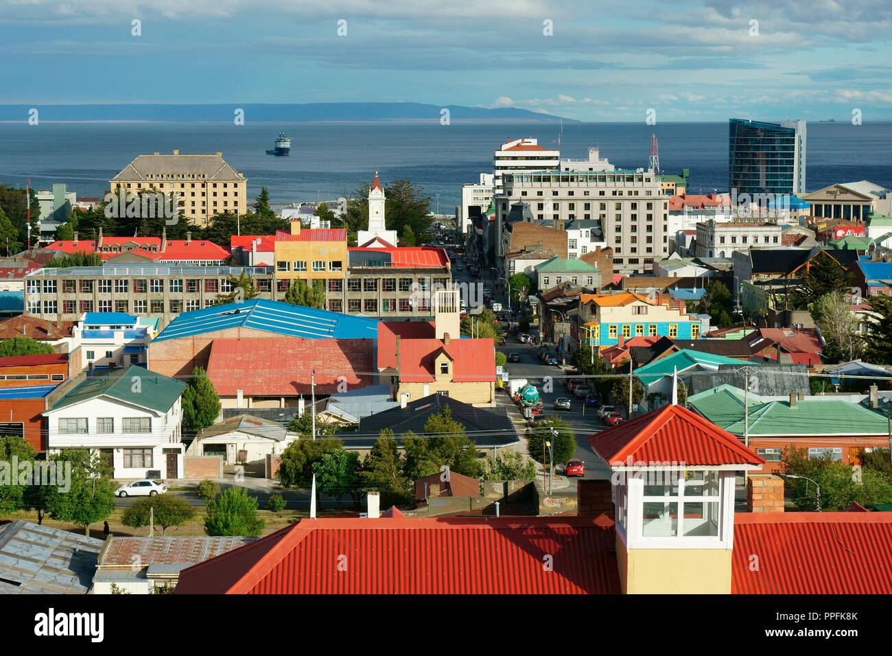 View over the city on the Magellan Strait, behind Tierra del Fuego, Punta Arenas, Magallanes, Patagonia, Chile - Stock Image