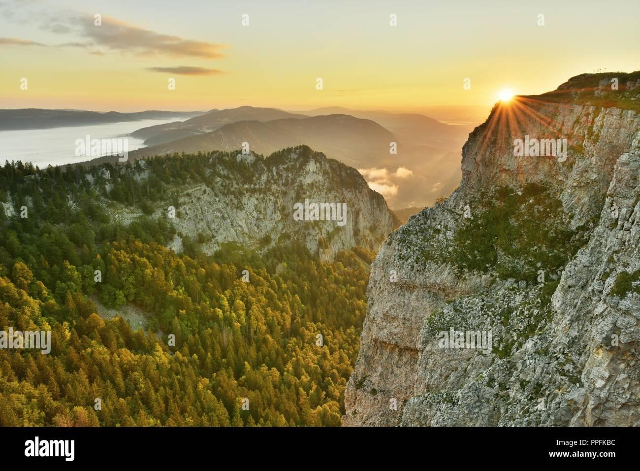 Creux du Van, rock face at sunrise, Le Soliat, canton of Jura, Switzerland - Stock Image