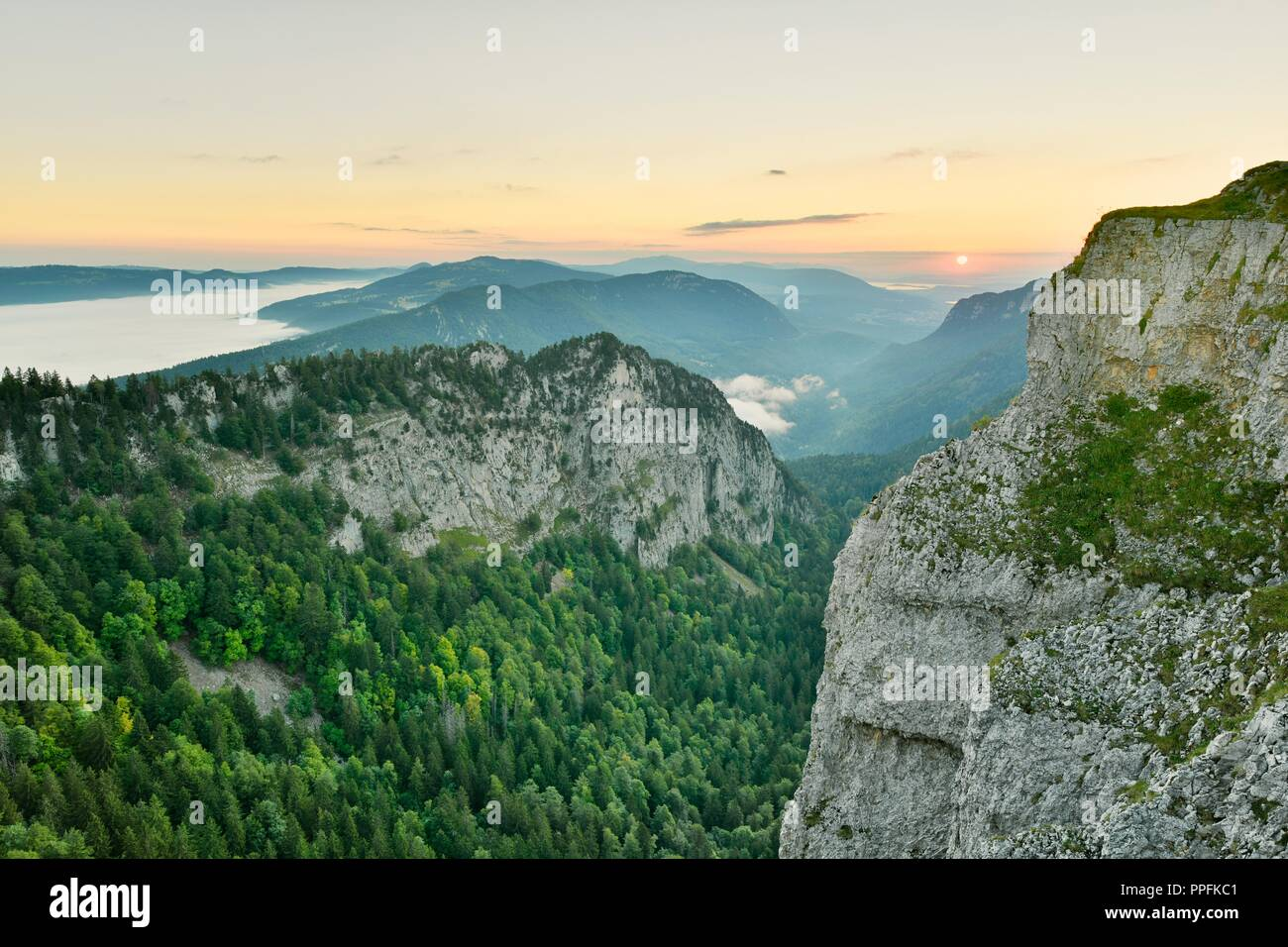 Creux du Van, rock face at sunrise, Le Soliat, canton of Jura, Switzerland - Stock Image