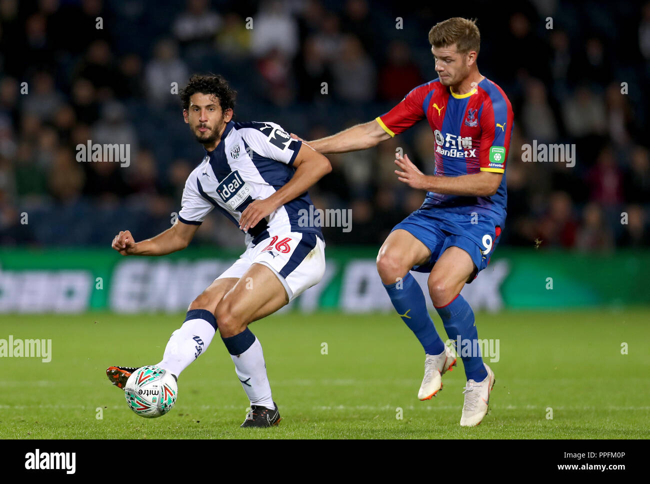 West Bromwich Albion's Dwight Gayle (left) and Crystal Palace's Alexander Sorloth battle for the ball during the third round Carabao Cup match at The Hawthorns, West Bromwich. - Stock Image