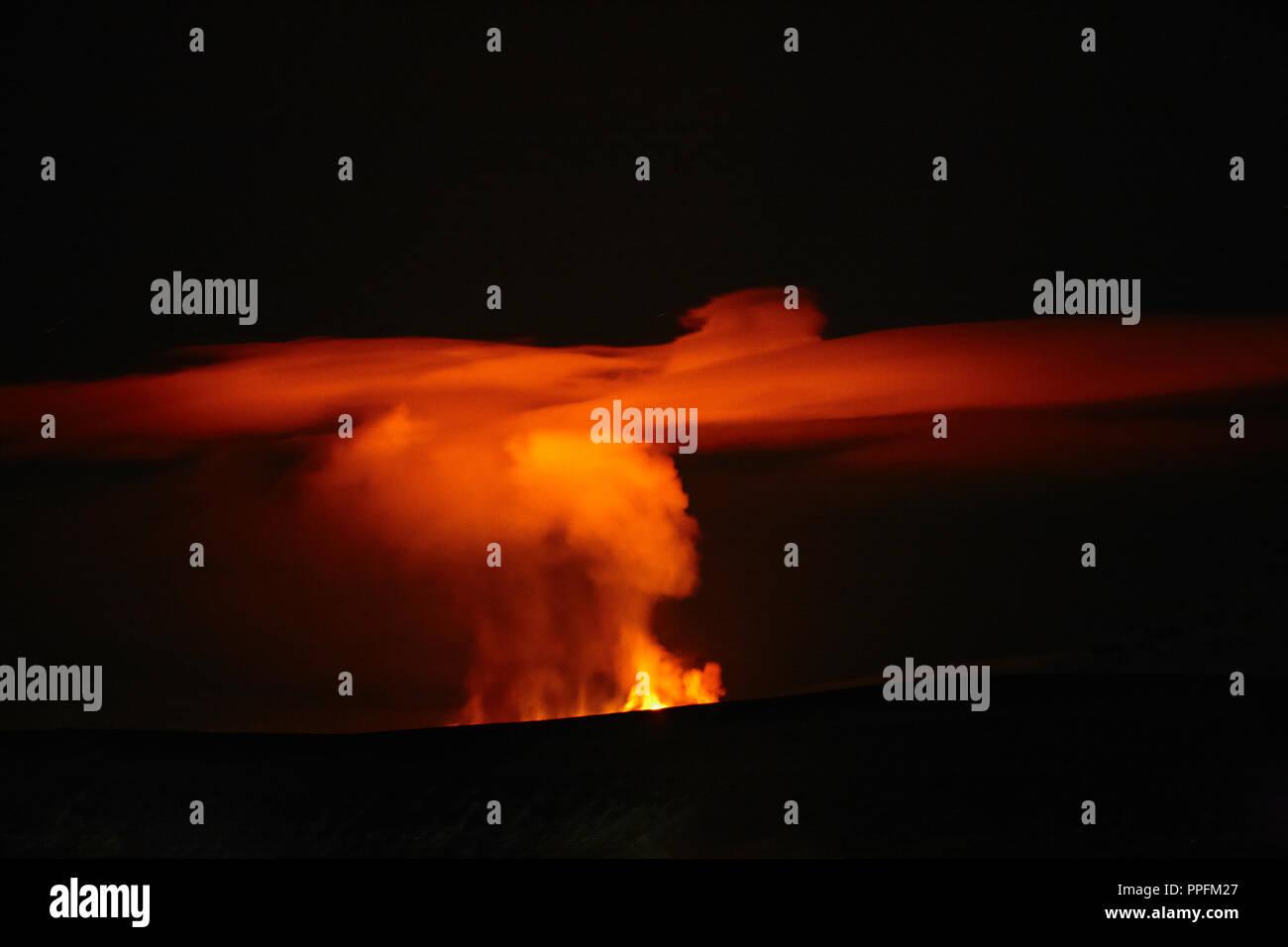 Volcanic eruption at Fimmvörðuháls, fissure eruption between Mýrdalsjökull and Eyjafjallajökull, at night, Iceland - Stock Image