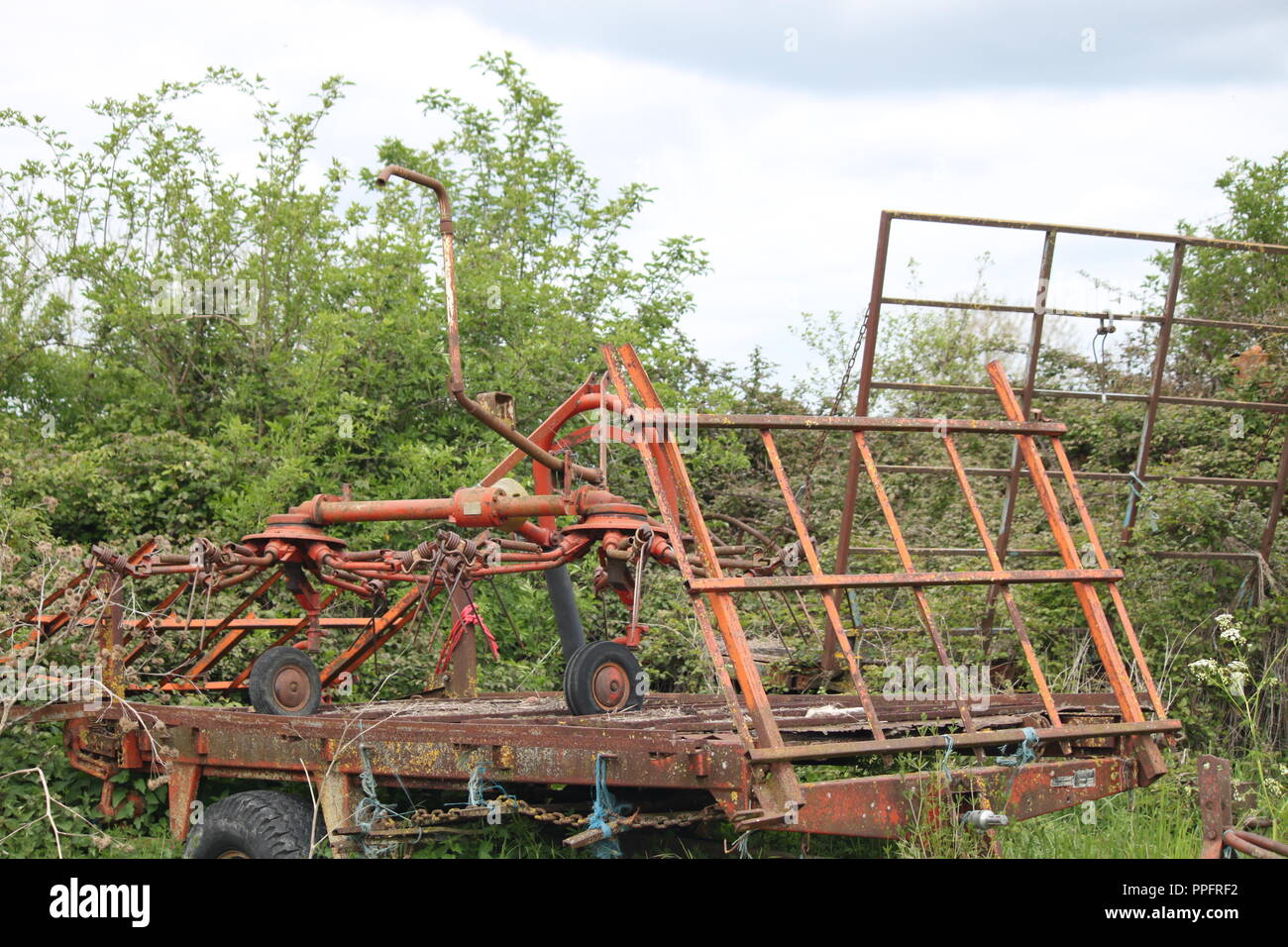 Abandoned farm machinery in France - Stock Image