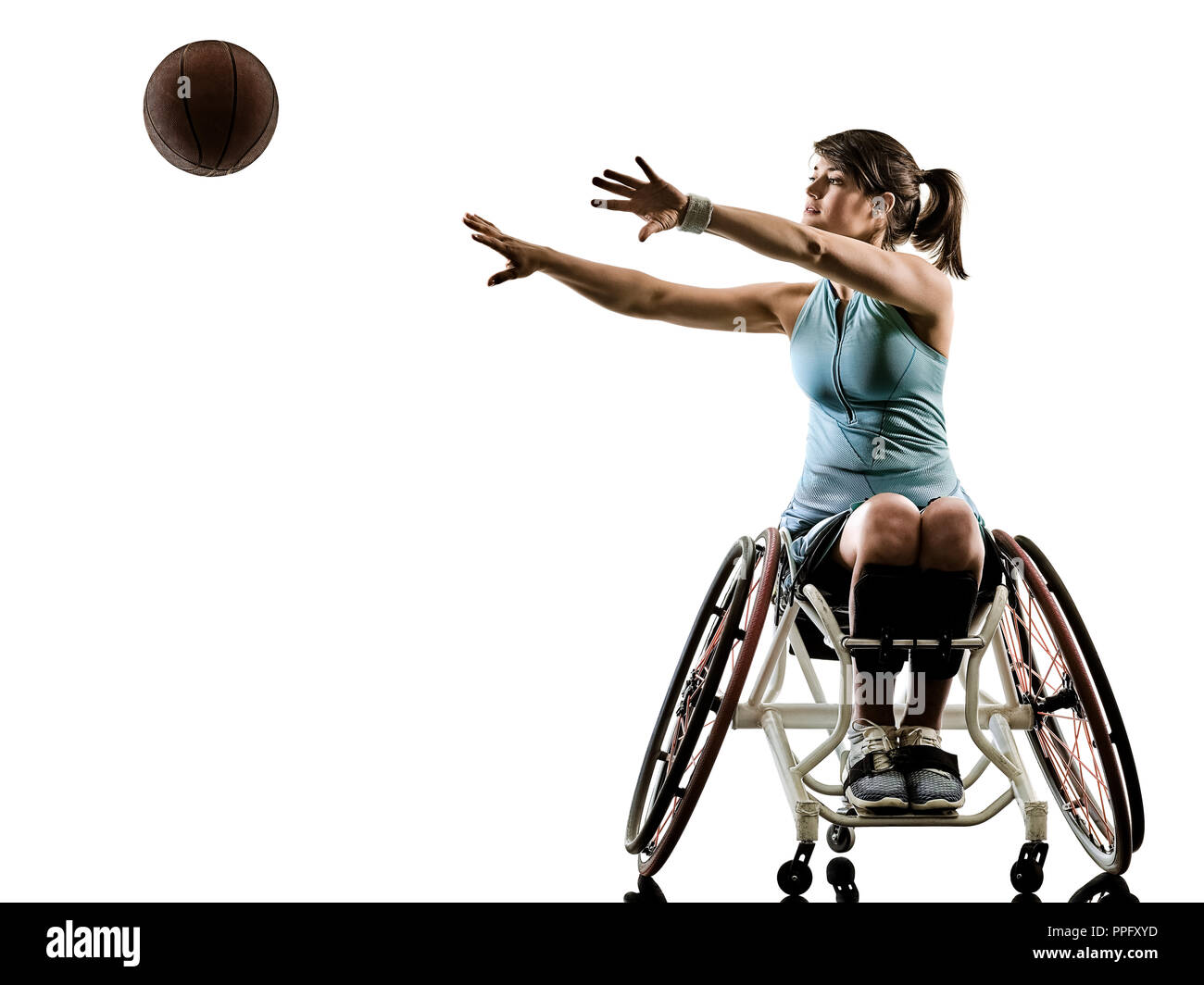 one caucasian young handicapped basket ball player woman in wheelchair sport  tudio in silhouette isolated on white background - Stock Image