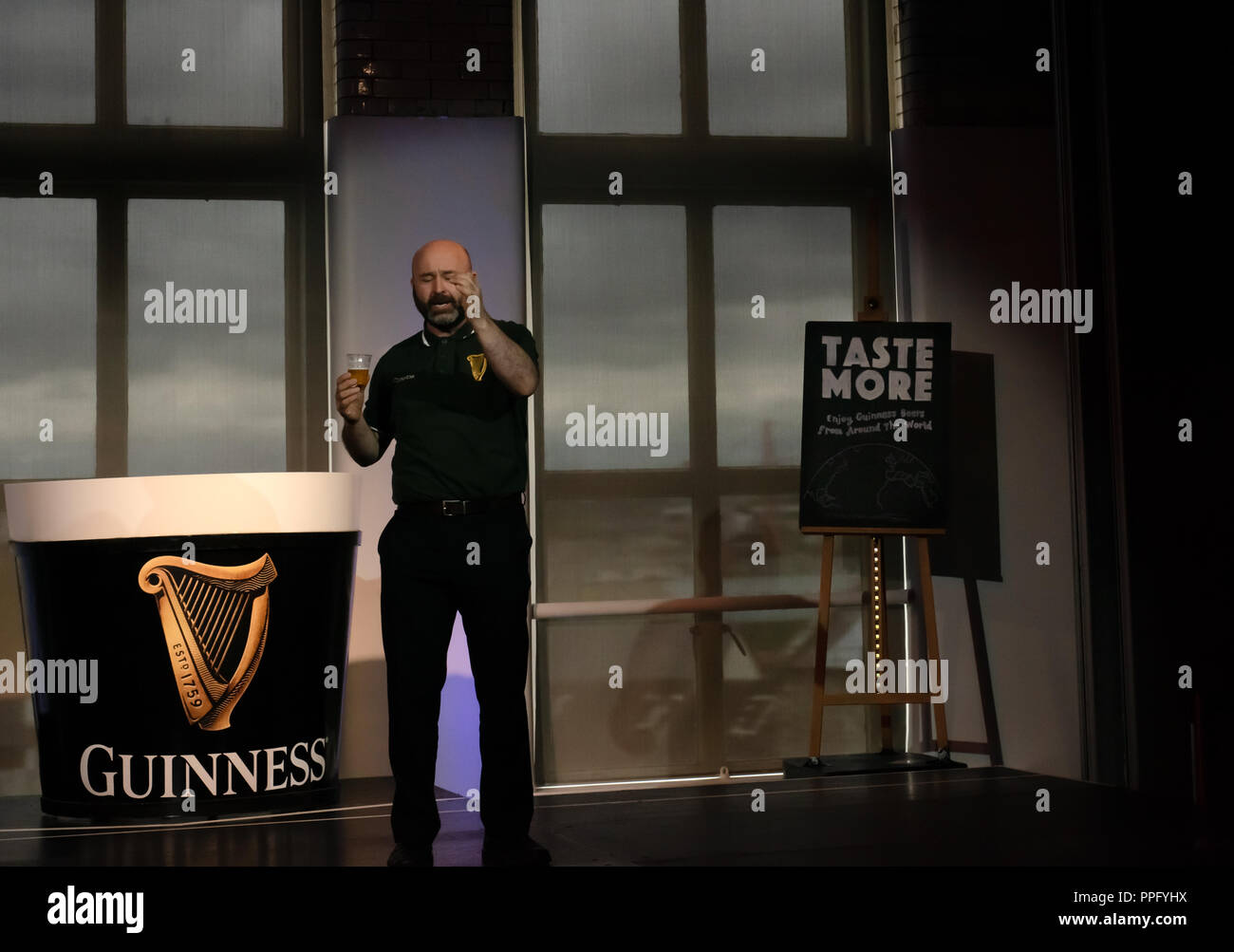 Live show at Guinness Storehouse. Presenter demonstrates on stage the Guinness Experience, Dublin, Ireland - Stock Image