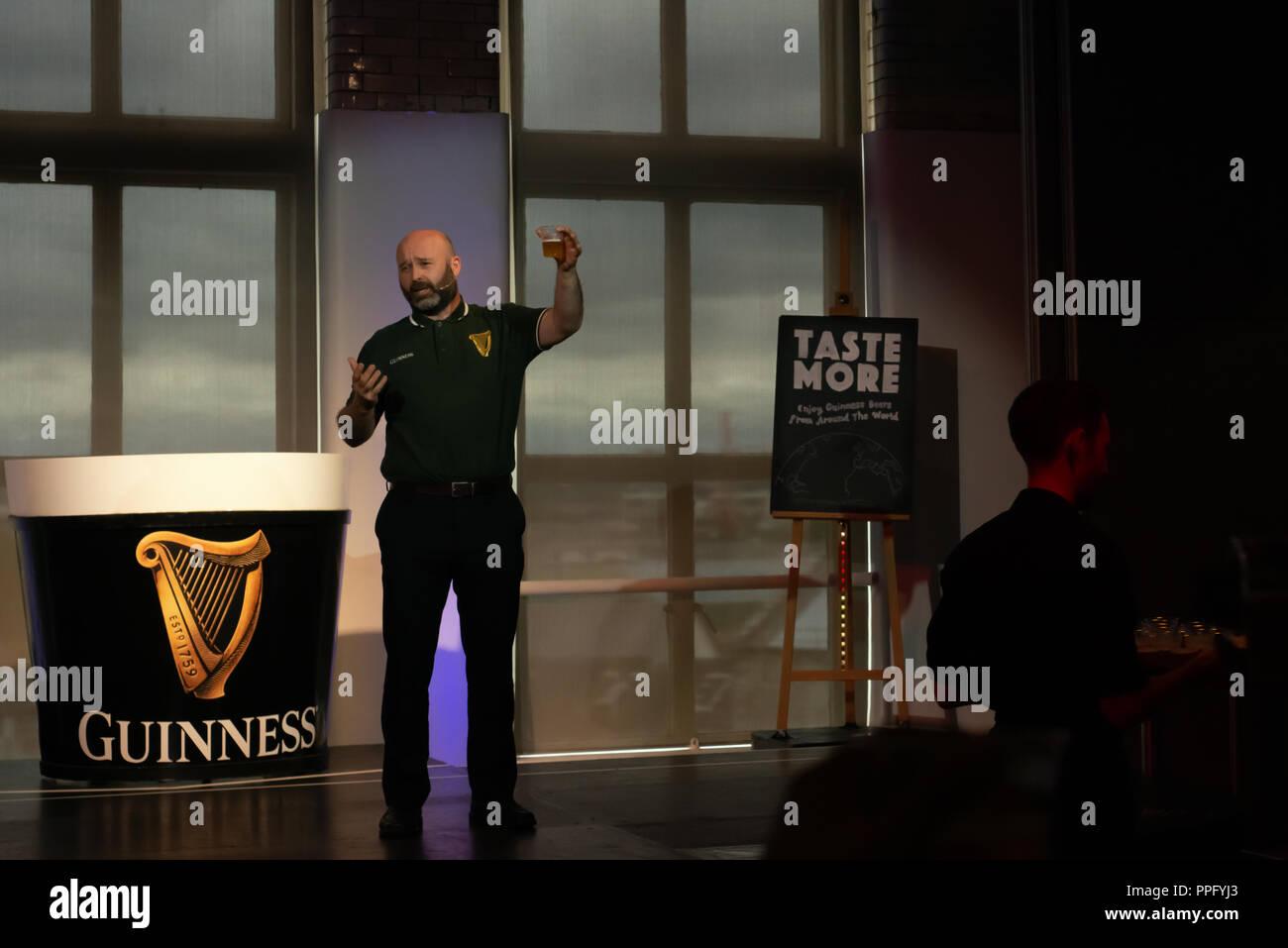 Guinness Storehouse Dublin. Live show. Presenter demonstrates on stage the Guinness Experience. St. James, Dublin, Ireland - Stock Image