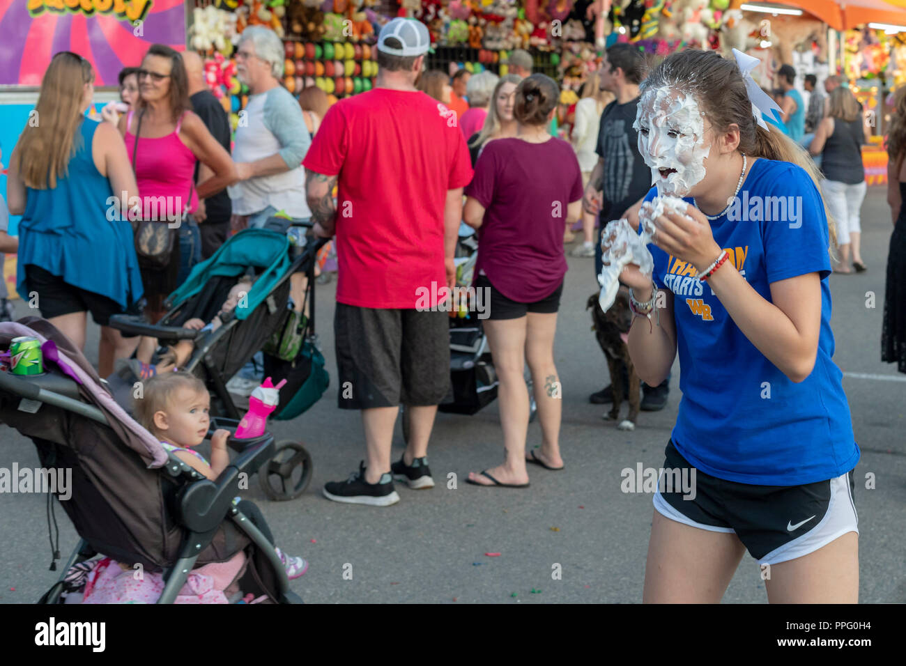 Wheat Ridge, Colorado - A high school student gets a pie in the face as a fundraiser during the annual Carnation Festival. No one seems to notice exce - Stock Image