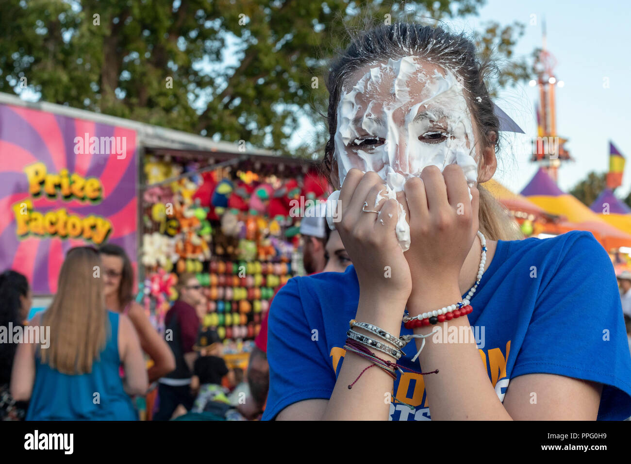 Wheat Ridge, Colorado - A high school student gets a pie in the face as a fundraiser during the annual Carnation Festival. The festival features food  - Stock Image