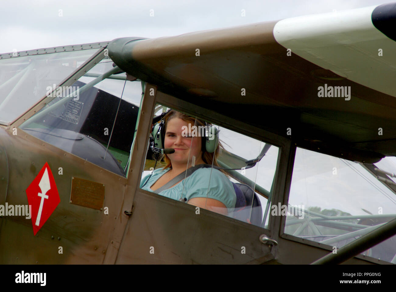 Leah Hammond at the controls of her plane Taylorcraft Aeroplanes Auster V G-AMVD. Female pilot. Married name Leah Young - Stock Image