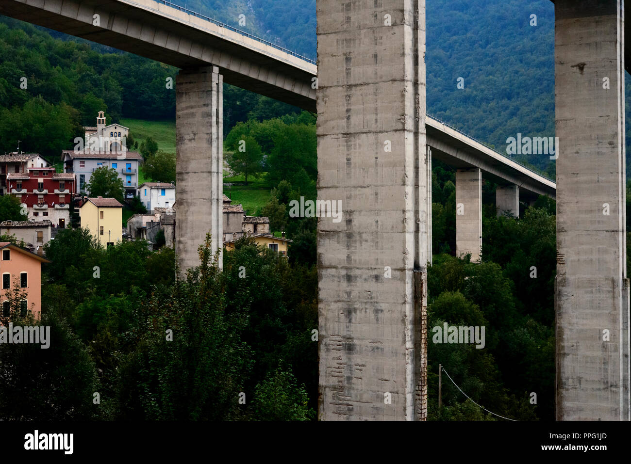 Highway bridge over ancient village - Stock Image