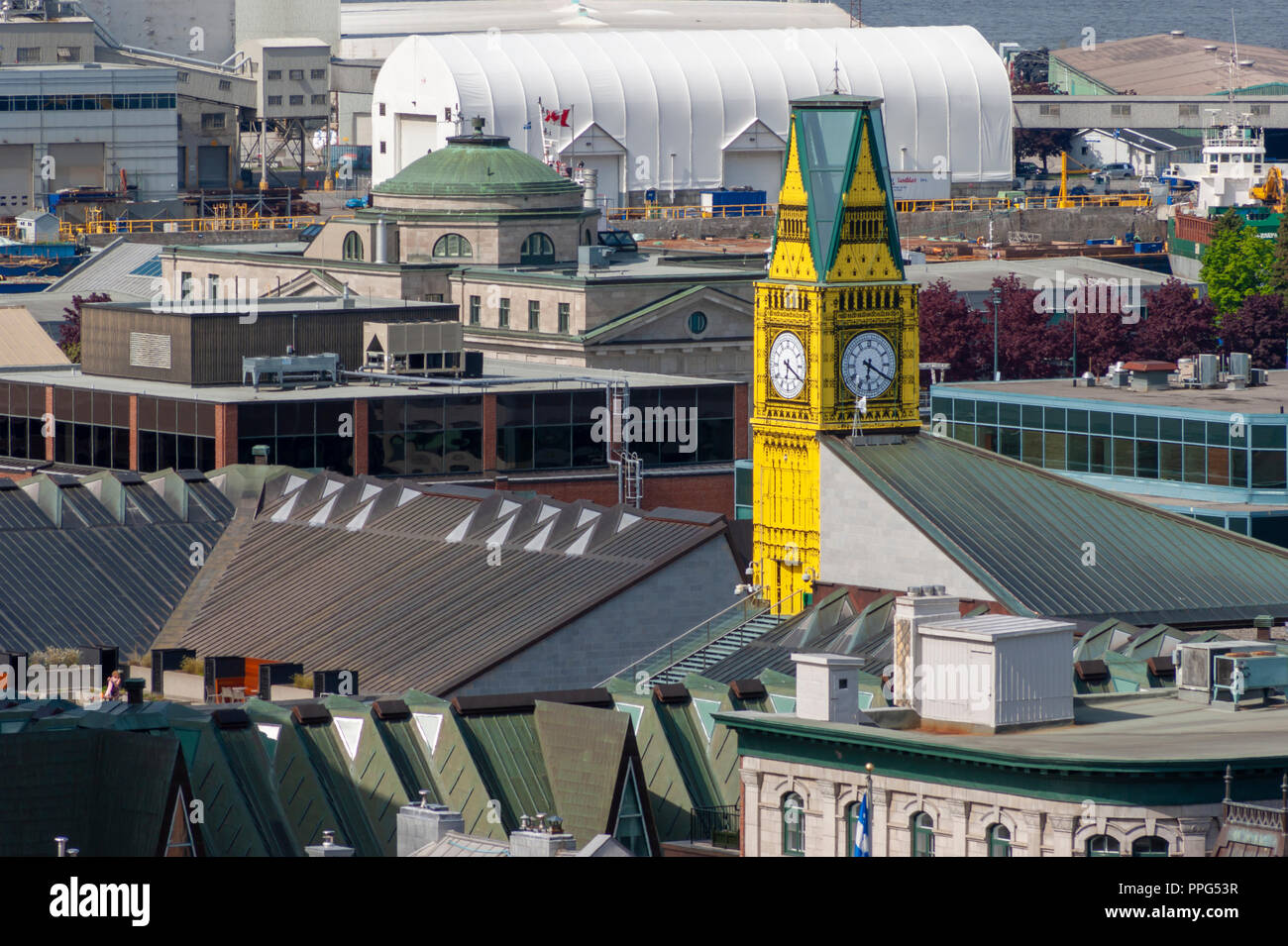 Big Ben replica installation at the Musee de la Civilisation, peeking above surrounding rooftops, in the historic district of Lower Town (Basse-Ville) - Stock Image