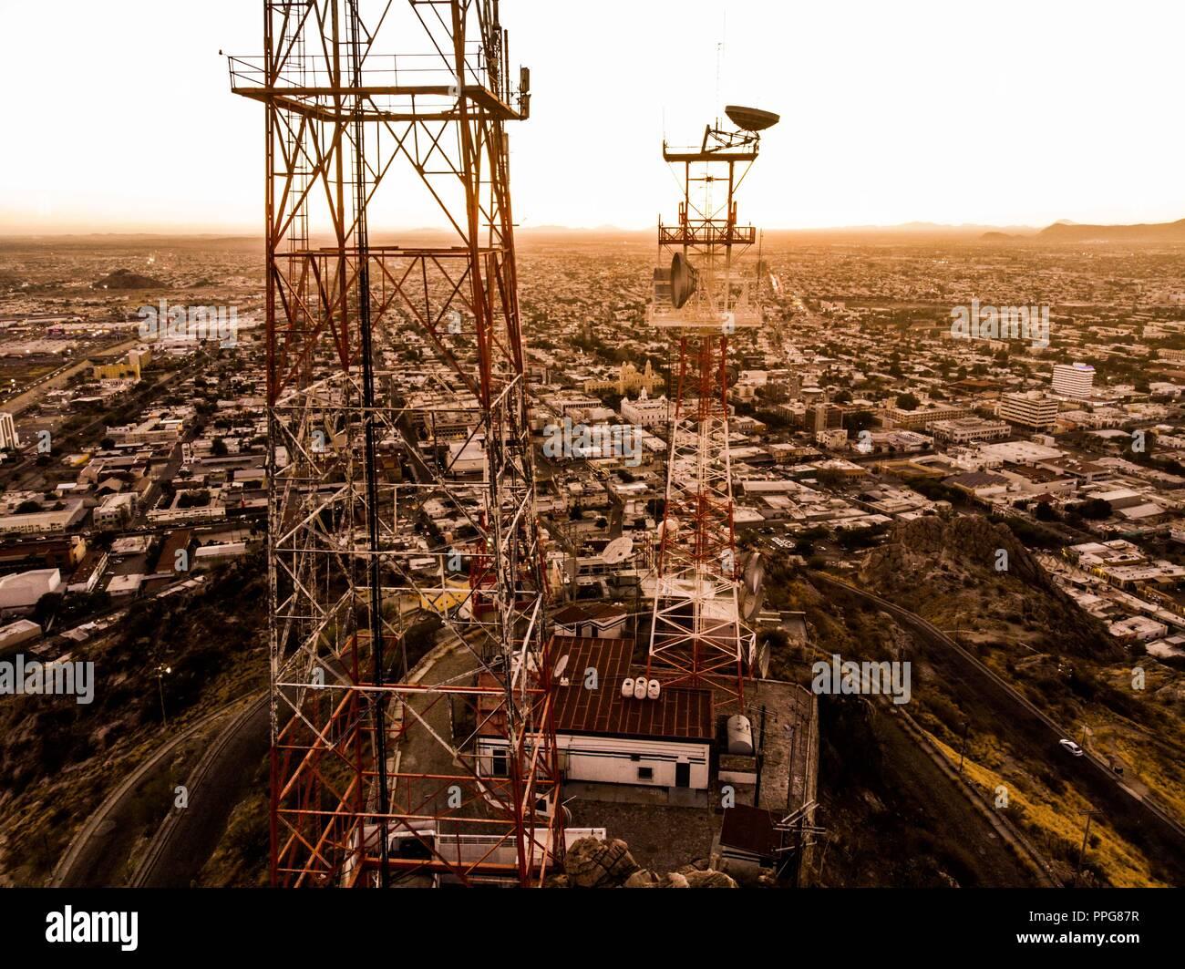 Cerro de la Campana Hill of the Bell. Tele communications. Antennas in the mountain SCT. Television antennas. Downtown Hermosillo Sonora. aerial Stock Photo