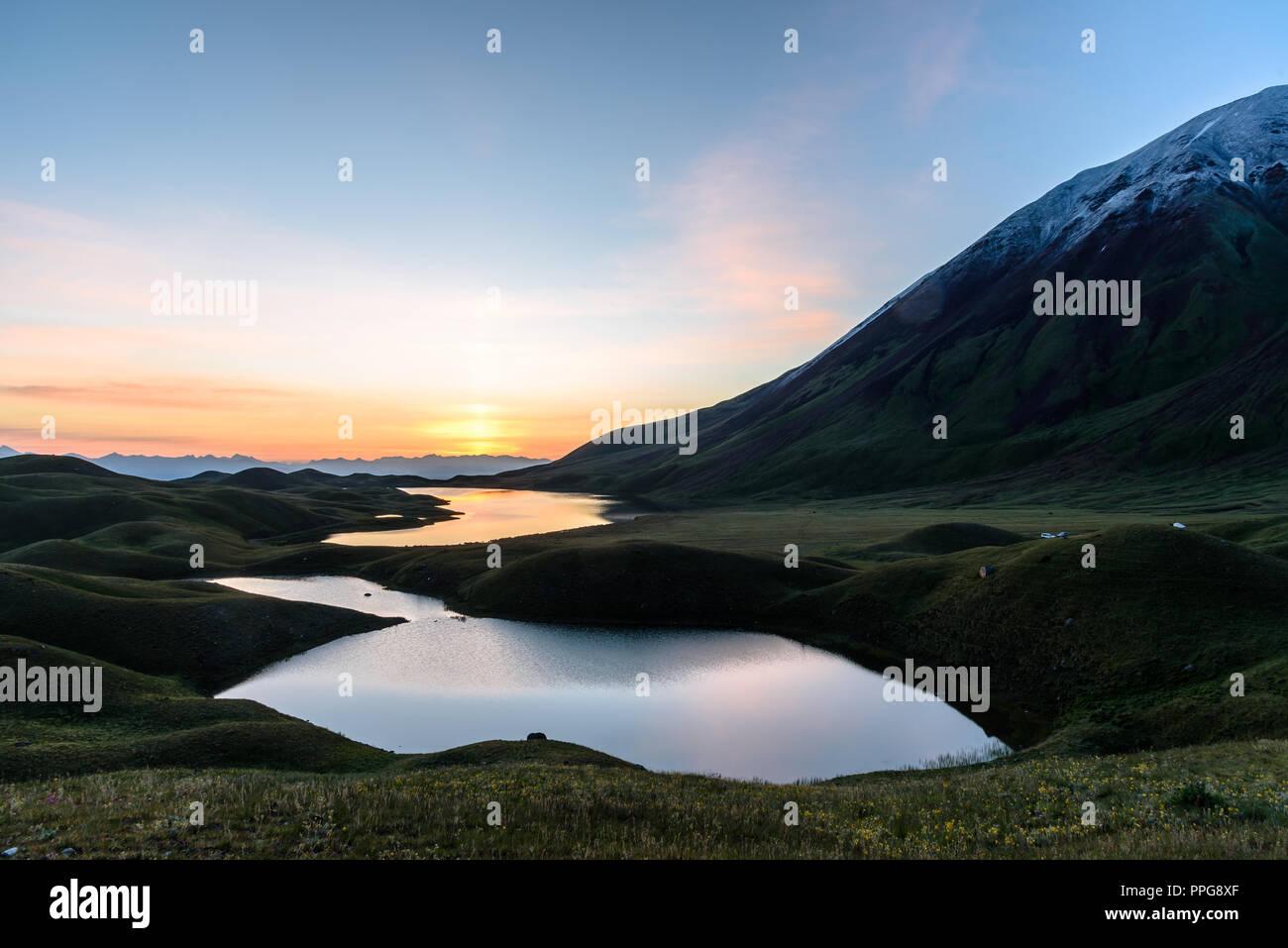 mountain lakes around Peak Lenin valley at sunrise, Kyrgyzstan Stock Photo