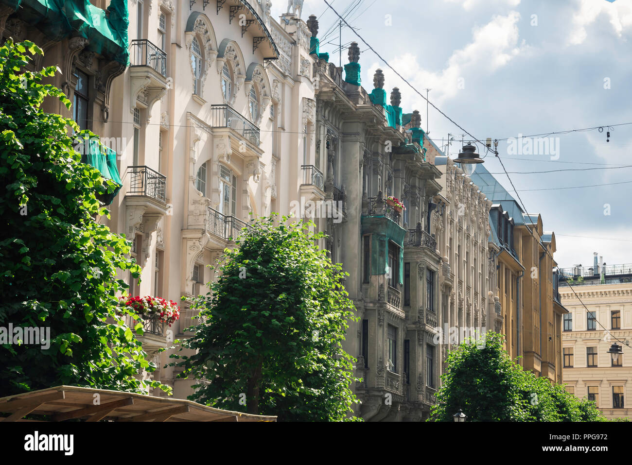 View of a row of Jugendstil style buildings (both renovated and unrenovated) on the north side of Alberta Iela in the Art Nouveau district of Riga. - Stock Image