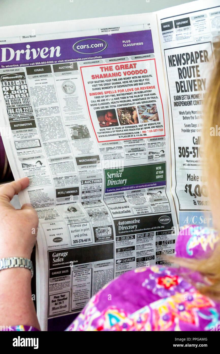 Miami Miami Florida Herald newspaper ads advertising shamanic voodoo spells ad woman reading - Stock Image