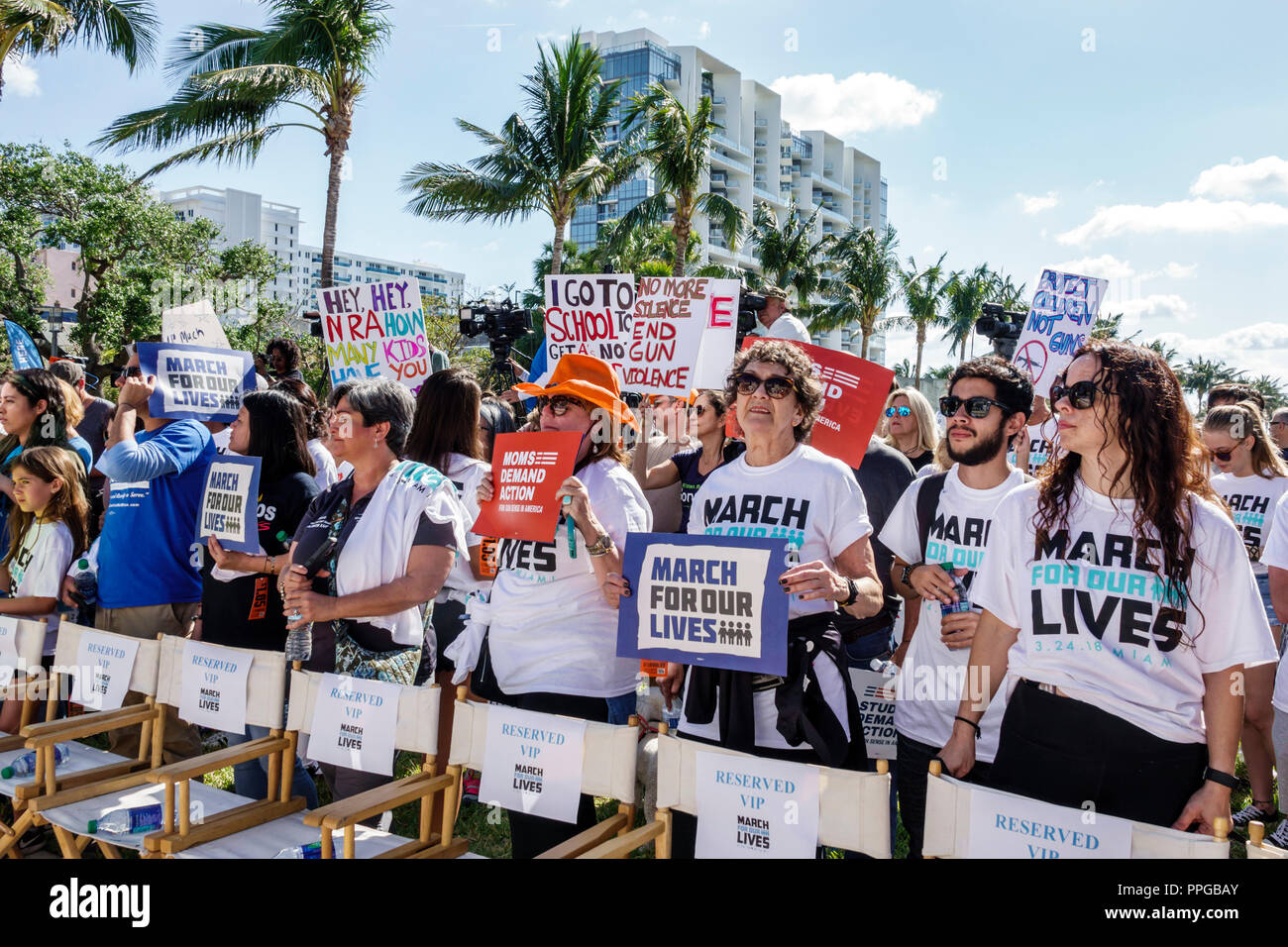 Miami Beach Florida Collins Park March For Our Lives public high school shootings gun violence protest student signs posters woman mothers holding - Stock Image