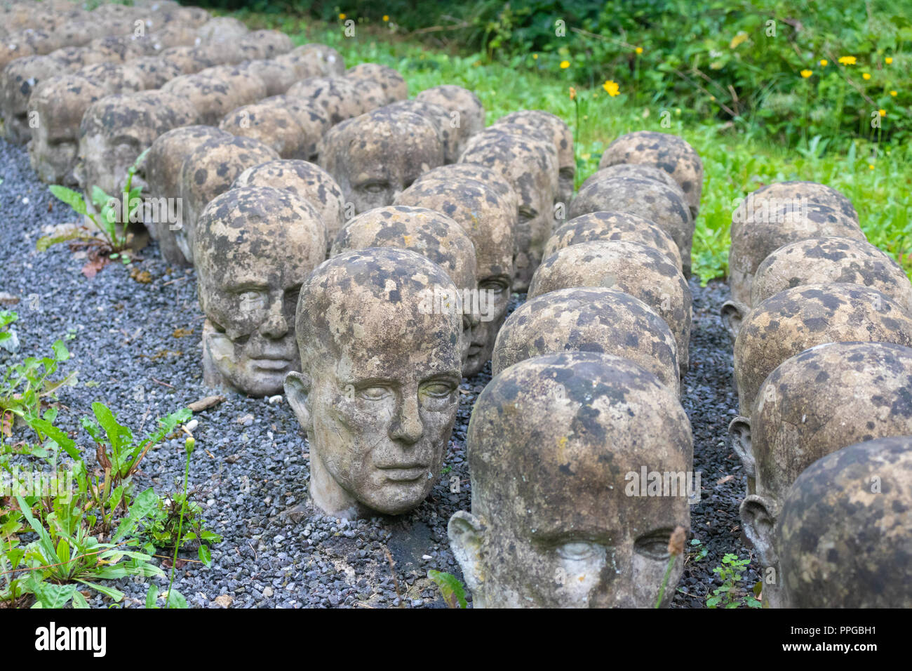 Holocaust Memorial of Rows of Heads on the way to Mauthausen Concentration Camp Austria. - Stock Image