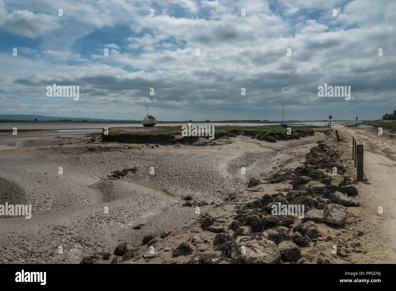 The remote Lancashire village of Sunderland Point on a June morning at low tide, England, UK with boats moored. Stock Photo