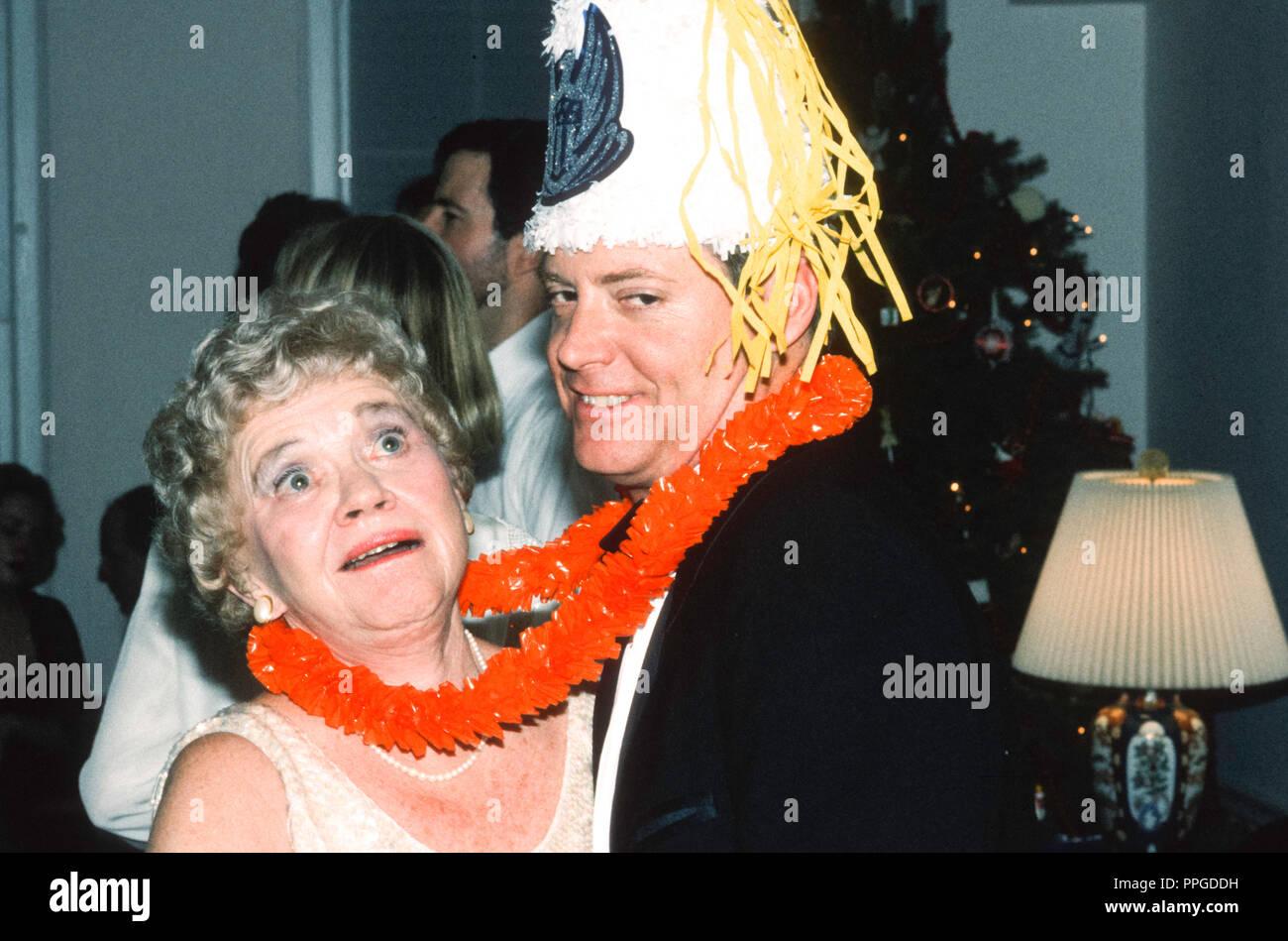 Humorous Party Scene,  Couple Dancing, 1980's, NYC, USA - Stock Image
