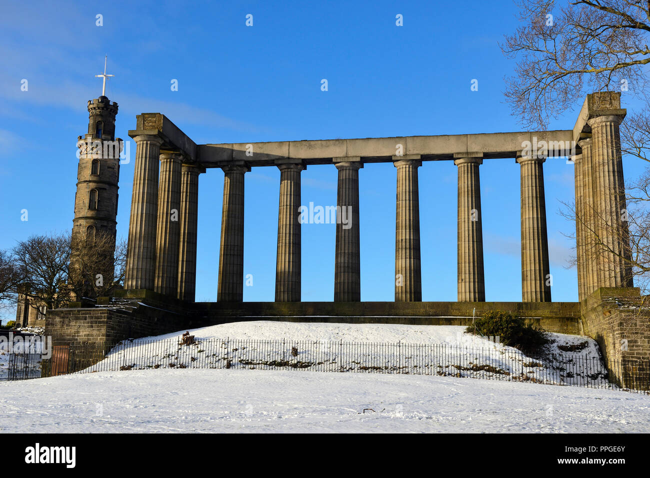 National Monument of Scotland and Nelson's Monument on Calton Hill in the snow, Edinburgh, Scotland Stock Photo