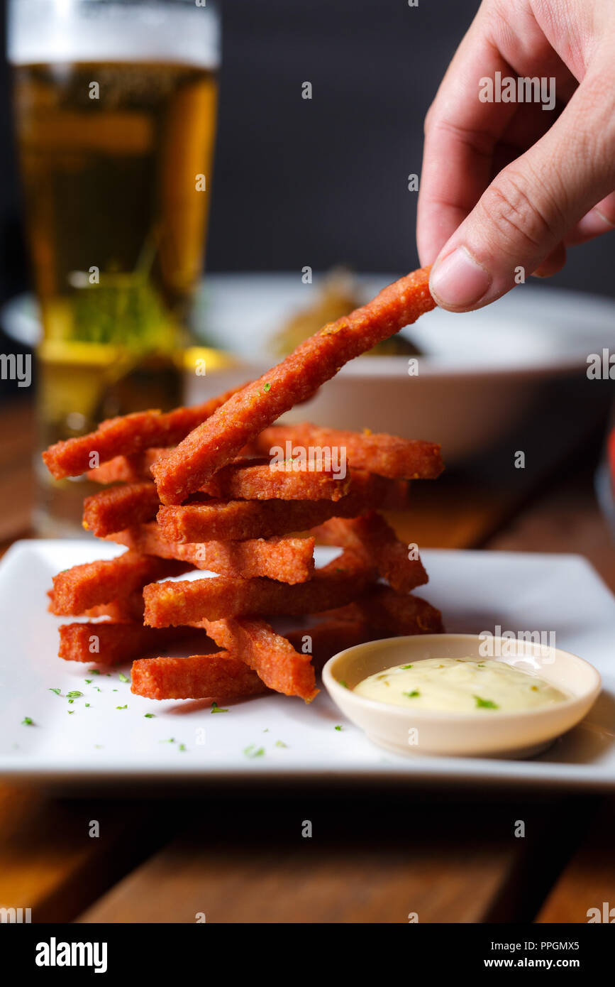 Close up shot of fine dining well prepared sweet potato dish with dipping sauce - Stock Image