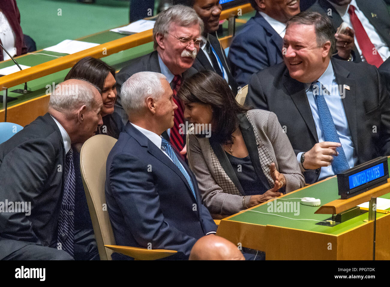 New York, USA, 25 September 2018. L-R: White House Chief of Staff John Kelly, press secretary Sarah Huckabee Sanders, US Vice-President Mike Pence, UN Ambassador Nikki Haley, National Security Advisor John Bolton and Secretary of State Mike Pompeo share a light moment at the United Nations General Assembly as they await the speech by President Donald Trump. Photo by Enrique Shore Credit: Enrique Shore/Alamy Live News - Stock Image