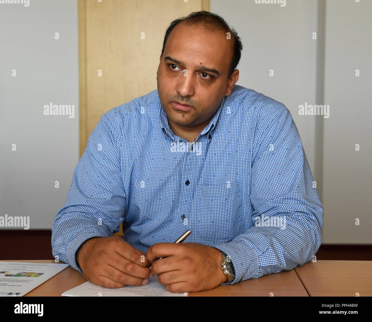 Director of the Czech Government Agency for Social Inclusion, Social Democrat (CSSD) David Benak gives an interview to Czech News Agency in Prague, Czech Republic, on September 21, 2018. Benak, who comes from a Roma family, first went to a vocational school of mechanical engineering in Most, north Bohemia, where he passed his secondary school-leaving exam in 1998. Then he graduated from the Social and Legal College and studied pedagogy at the Faculty of Arts of Charles University in Prague.From 2005 to 2015, Benak worked at the Prague 14 Town Hall where he headed the social section. From June - Stock Image