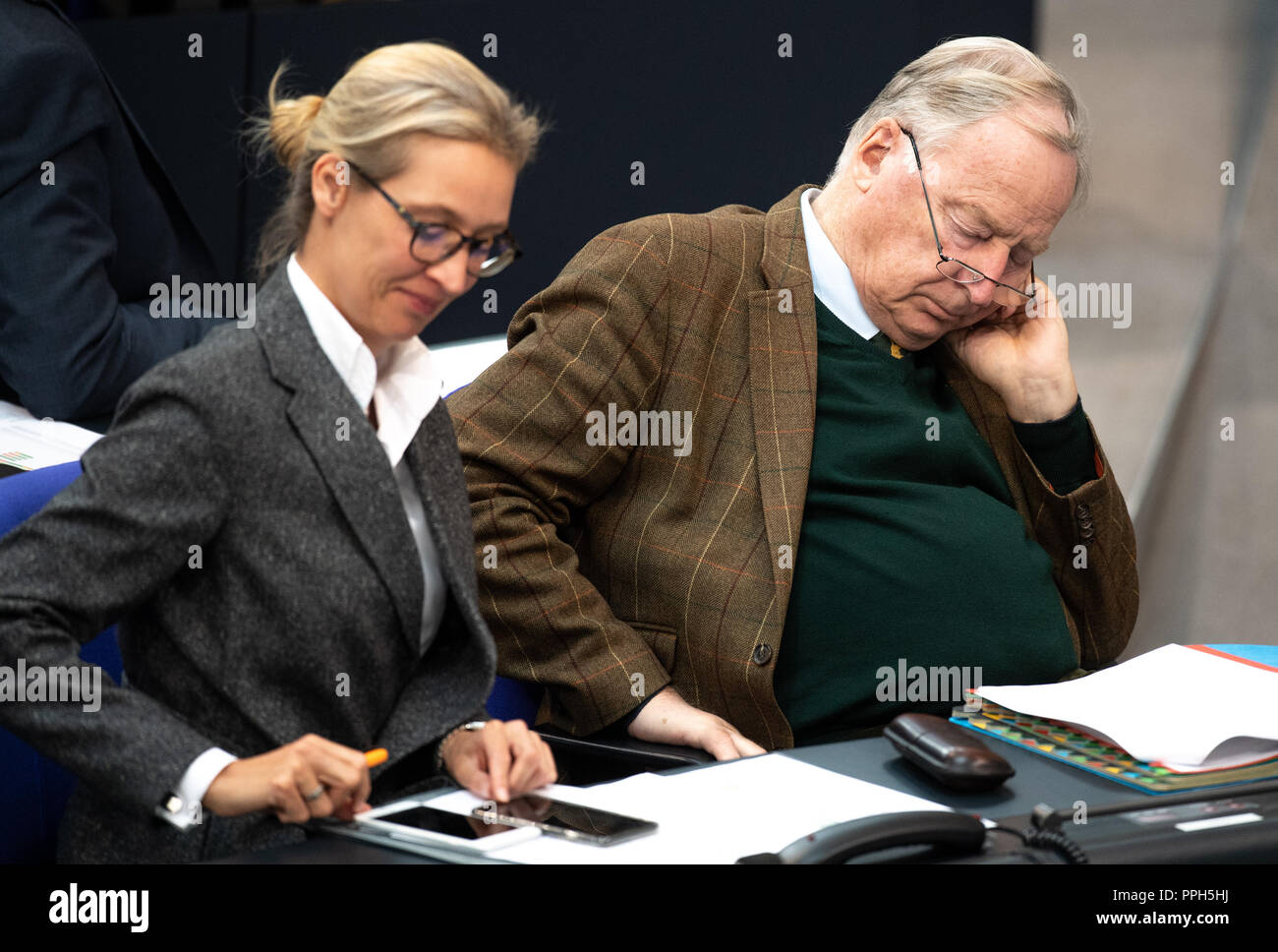 26 September 2018, Berlin: Alice Weidel (AfD), leader of the parliamentary group, and Alexander Gauland (AfD), leader of the parliamentary group, take part in the plenary session of the German Bundestag. Topics of the 51st session are a government survey with Health Minister Spahn (CDU) on the 'law for faster appointments and better care' and a question time on the results of the housing summit in Berlin. Photo: Fabian Sommer/dpa - Stock Image